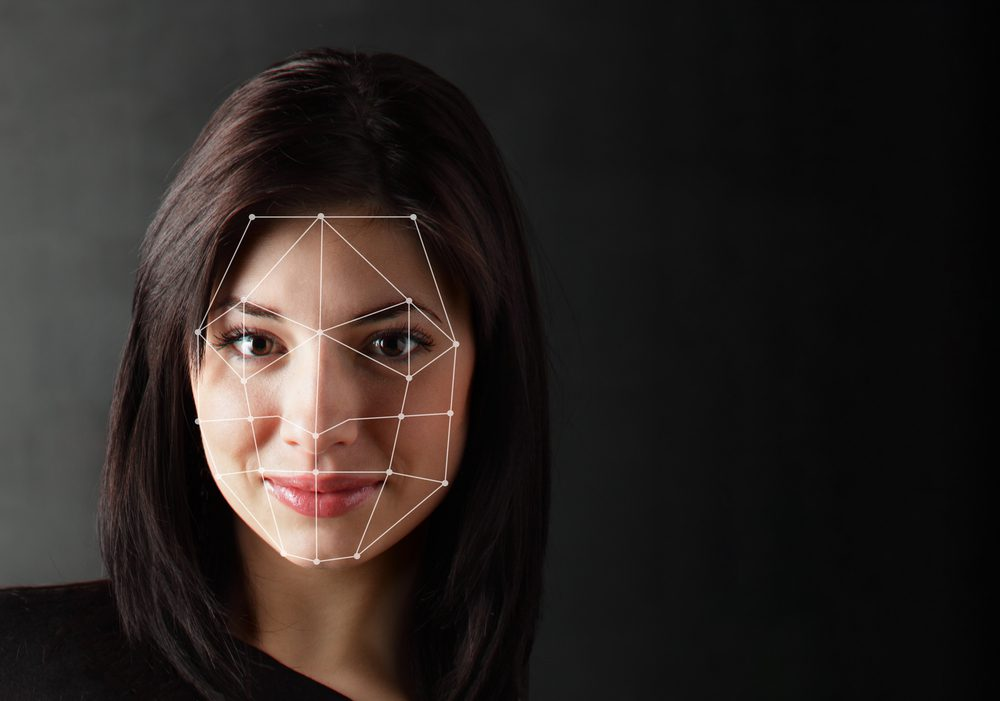 A woman's face being scanned and created using CGI technology.